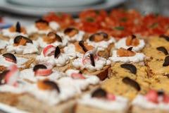 Surimi Tartines. Homemade tartines, with fisheggs cream, surimi and olives Royalty Free Stock Photo