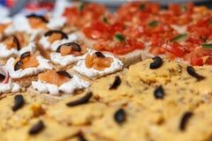 Surimi Tartines 2. Homemade tartines, with fisheggs cream, surimi and olives Royalty Free Stock Image