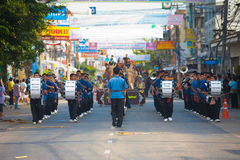 Surin Elephant Roundup Marching Band. SURIN, ISAN, THAILAND - NOVEMBER 19, 2010: A marching band of young teenagers walks down a street in a parade at the annual Royalty Free Stock Photo