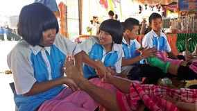 Asian student group is massaging to their foot customer. SURIN, THAILAND – JULY 10, 2018:  Asian student group is massaging to their foot customer,  the Royalty Free Stock Image