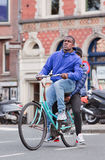 Surinam guy on a rusty blue bicycle, Amsterdam, Netherlands Stock Photos