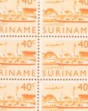 A stamp printed in Suriname shows a city, circa 1970. Suriname - CIRCA 1970: A stamp printed in Suriname shows a city, circa 1970 royalty free stock photos