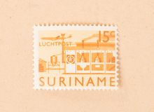 A stamp printed in Suriname shows a factory, circa 1970. Suriname - CIRCA 1970: A stamp printed in Suriname shows a factory, circa 1970 royalty free stock photo