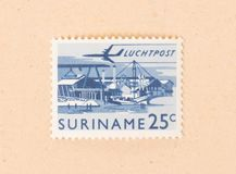 A stamp printed in Suriname shows a harbour, circa 1970. Suriname - CIRCA 1970: A stamp printed in Suriname shows a harbour, circa 1970 stock images