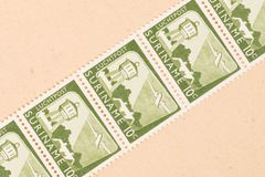 A stamp printed in Suriname shows a watertower and an airplane, circa 1970. Suriname - CIRCA 1970: A stamp printed in Suriname shows a watertower and an airplane stock photo