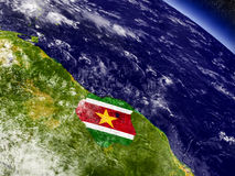 Suriname with embedded flag on Earth Royalty Free Stock Image