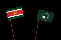 Suriname flag with African Union flag  on black Royalty Free Stock Photos