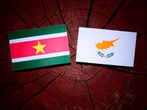 Suriname flag with Cypriot flag on a tree stump isolated Stock Images