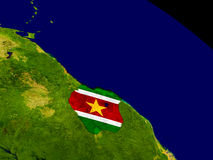Suriname with flag on Earth Stock Images