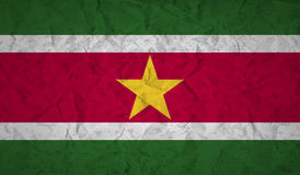 Suriname flag with the effect of crumpled paper and grunge Stock Photography