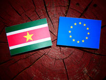 Suriname flag with EU flag on a tree stump isolated Royalty Free Stock Photography
