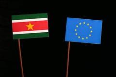 Suriname flag with European Union EU flag  on black Stock Image