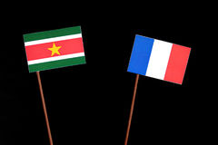 Suriname flag with French flag  on black. Background Stock Photos