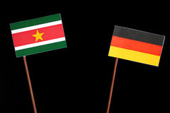 Suriname flag with German flag  on black. Background Royalty Free Stock Images