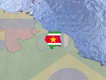Suriname with flag on globe Royalty Free Stock Images