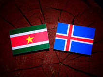 Suriname flag with Icelandic flag on a tree stump isolated Royalty Free Stock Photography