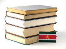 Suriname flag with pile of books  on white background Stock Photography
