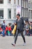 Suriname girl walks at Dam Square, Amsterdam, Netherlands Stock Images
