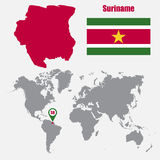 Suriname map on a world map with flag and map pointer. Vector illustration Stock Image