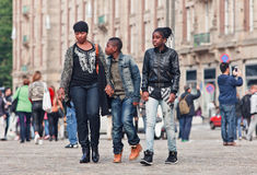 Suriname mother and kids on Dam Square, Amsterdam, Netherlands Royalty Free Stock Image