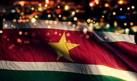 Suriname National Flag Light Night Bokeh Abstract Background Stock Photos