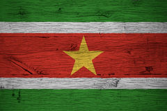 Suriname national flag painted old oak wood Stock Photos