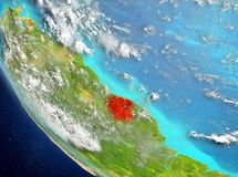 Satellite view of Suriname in red. Suriname from orbit of planet Earth with highly detailed surface textures. 3D illustration. Elements of this image furnished Royalty Free Stock Photography