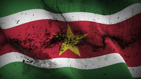 Suriname grunge dirty flag waving on wind. Surinamese background fullscreen grease flag blowing on wind. Realistic filth fabric texture on windy day Royalty Free Stock Photography