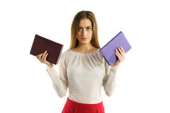 Surious student girl with book in hands Royalty Free Stock Photos
