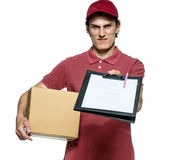 Surly courier in red uniform with a box and tablet requires subscribe Royalty Free Stock Photography