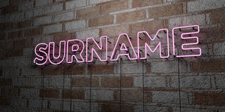 SURNAME - Glowing Neon Sign on stonework wall - 3D rendered royalty free stock illustration Royalty Free Stock Photos