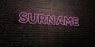 SURNAME -Realistic Neon Sign on Brick Wall background - 3D rendered royalty free stock image Royalty Free Stock Photography