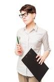 Surowa poważna biznesowa kobieta z falcówką w jego ręce zdjęcie stock