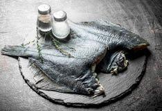 Surowa ryba na kamień desce z pikantność i macierzanką obrazy royalty free