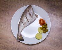 Surowa uncooked ryba na talerzu obraz royalty free