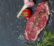 Surowego mięsa stek z świeżymi ziele i solą Fotografia Royalty Free