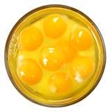 Surowi jajka w Szklanym pucharze Nad bielem fotografia stock