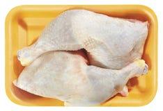 Surowy kurczaka mięso w plastikowej tacy odizolowywającej na białym tle Zdjęcie Royalty Free