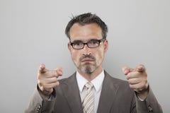Surowy nauczyciel wskazuje jego forefingers na tobie Fotografia Royalty Free