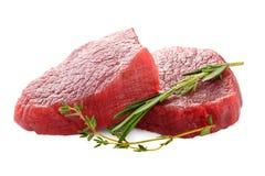 Surowy wołowina stek z rozmarynami i macierzanką odizolowywającymi na bielu Obraz Royalty Free