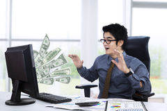 Surpised businessman getting money Royalty Free Stock Image