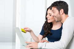 Surpised couple internet shopping Stock Photography