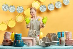Surpised hesitant mad young fair-haired girl hates to do some chores royalty free stock images