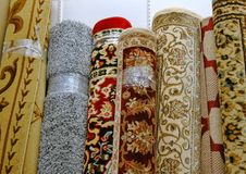 Surplus Carpet, Decorating On A Budget. Typical mass market floor coverings for sale in a surplus store royalty free stock photo