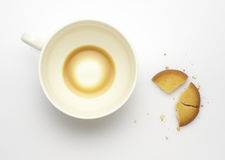 Surplus of coffee and broken biscuits. Surplus of coffee and broken cookies on a white background Royalty Free Stock Photo