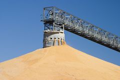 Surplus Corn harvest pile. Corn harvest elevator conveyor pile royalty free stock photography