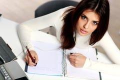 Surpprised Student Doing Her Homework Royalty Free Stock Image