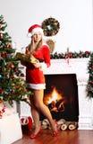 Surpresa para a menina do Natal Fotos de Stock Royalty Free