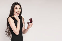 Surpriced woman holding jewelry box Royalty Free Stock Images