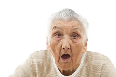 Surpriesd lady. Surprised old woman's portrait isolated on white Royalty Free Stock Image